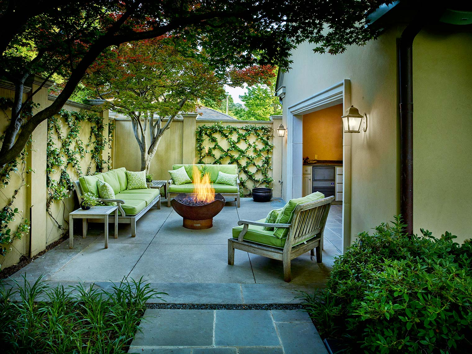 outdoor living areas with fire pits and  outdoor furniture.