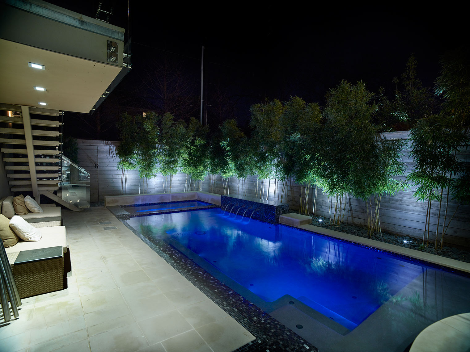 night view of outdoor lighted pool area